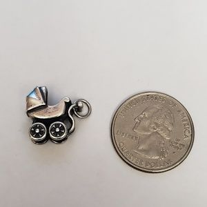James Avery retired baby stroller with baby charm